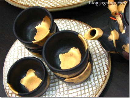 Teacups and pot with golden enameling