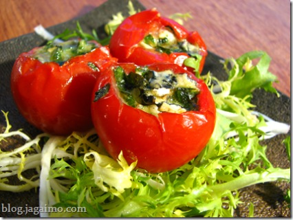 Roasted tomatoes stuffed with cheese and basil