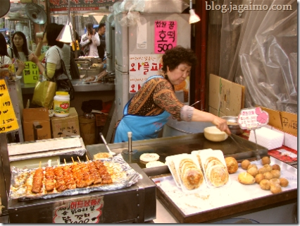 Streetside ajumma preparing sweet Korean pancakes