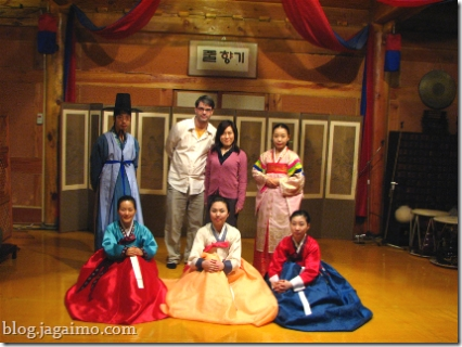 Traditional Korean music and dance performers, with two tourists