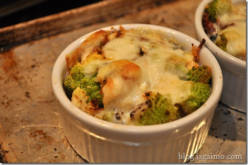 Baked romanesco broccoli with mozzarella, sundried tomatoes, and pine nuts
